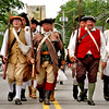 Here marching along Main Street in the Pepperell 4th of July Parade is the 6th Middlesex Regiment, Minutemen group. Nashoba Valley Voice Photo by David H. Brow