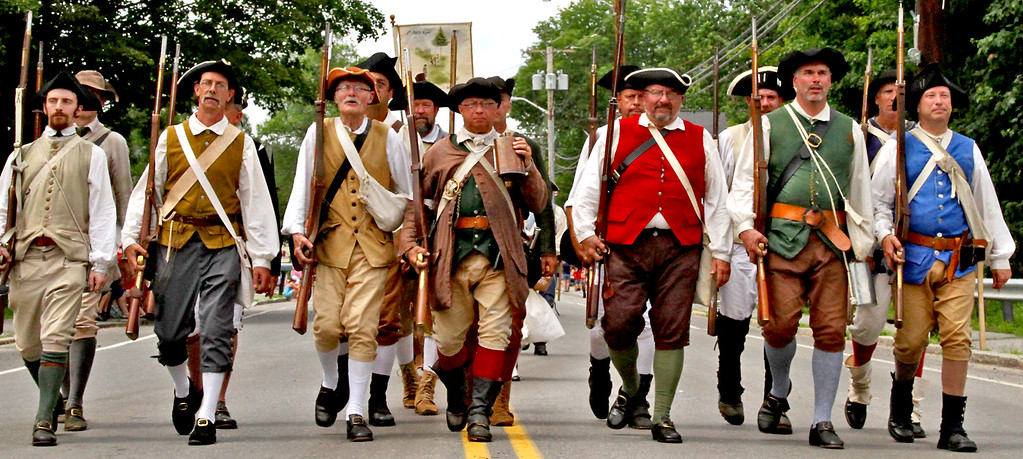 . Here marching along Main Street in the Pepperell 4th of July Parade is the 6th Middlesex Regiment, Minutemen group. Nashoba Valley Voice Photo by David H. Brow