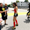 Being greeted by WonderWoman, played by Kate Jurdi, are Pepperellresidents, Eleanor Haueisen, 5, her dad, Shawn Haueisen holding Wesley H aueisen, 3. Nashoba Valley Voice Photo by David H. Brow