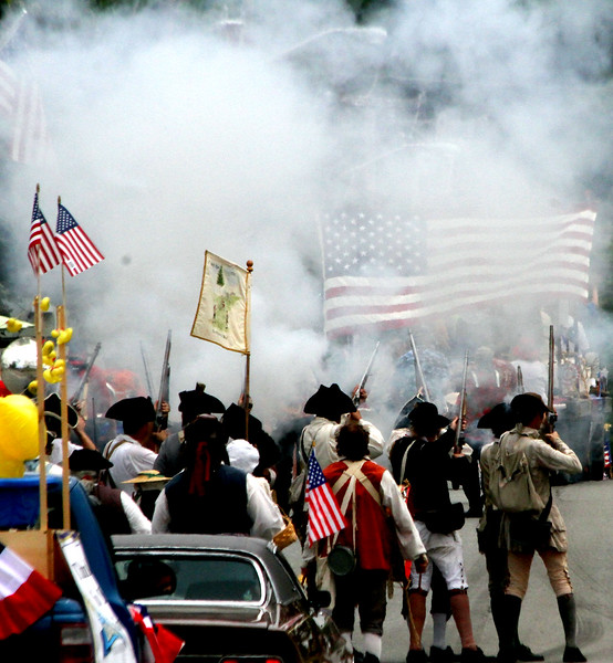 Minuteman group, 6th Middlesex Regiment, fires off a volley during the Pepperell 4th of July Parade. Nashoba Valley Voice Photo by David H. Brow