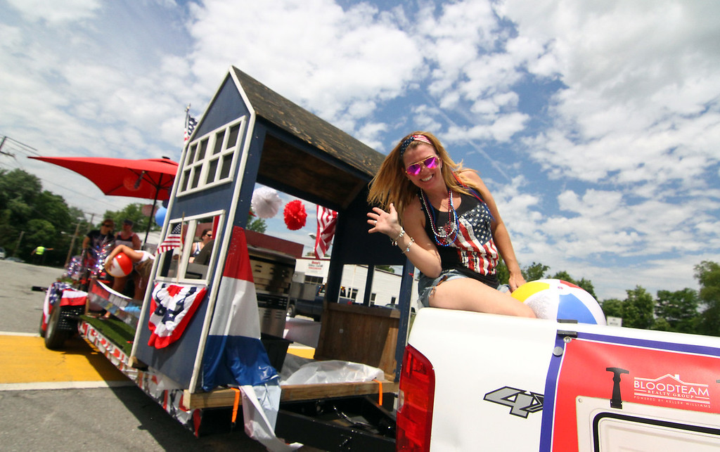. Missy Fernale on the BloodTeam RE Float in the Pepperell 4thof July Parade. Nashoba Valley Voice Photo by David H. Brow