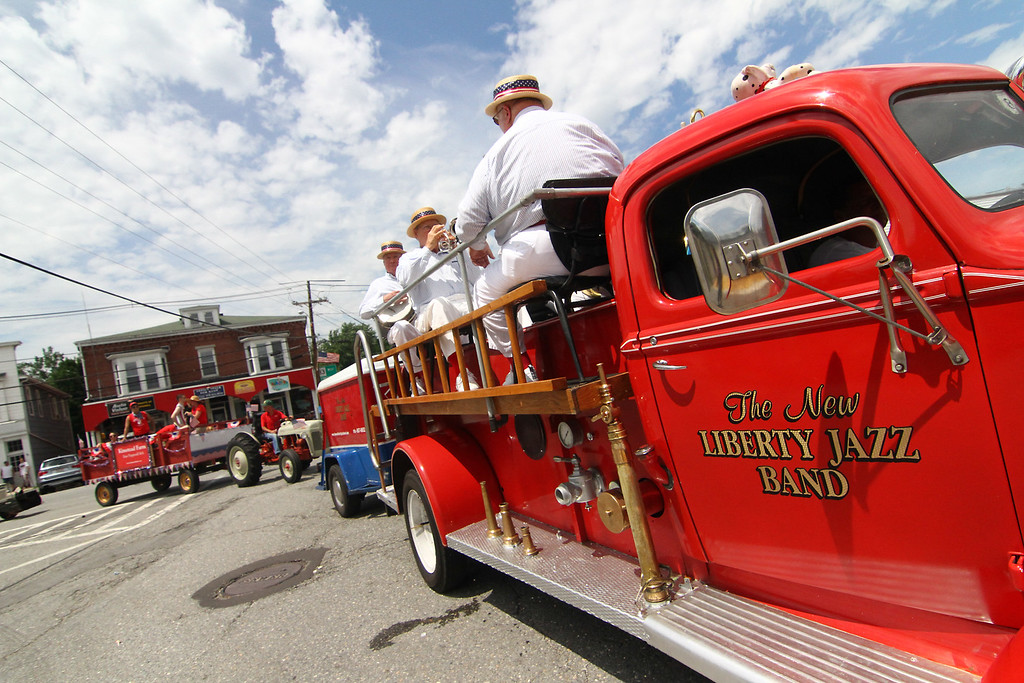 . Members of the New Liberty Jazz Band play on an old fire truck in the Pepperell 4th of July Parade. Nashoba Valley Voice Photo by David H. Brow