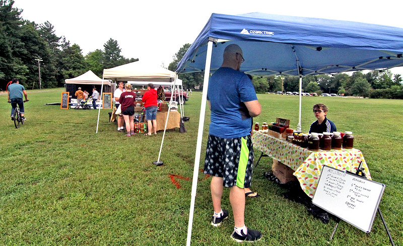 Locals get an early start at the Pepperell Farmers Market. SUN/David H. Brow