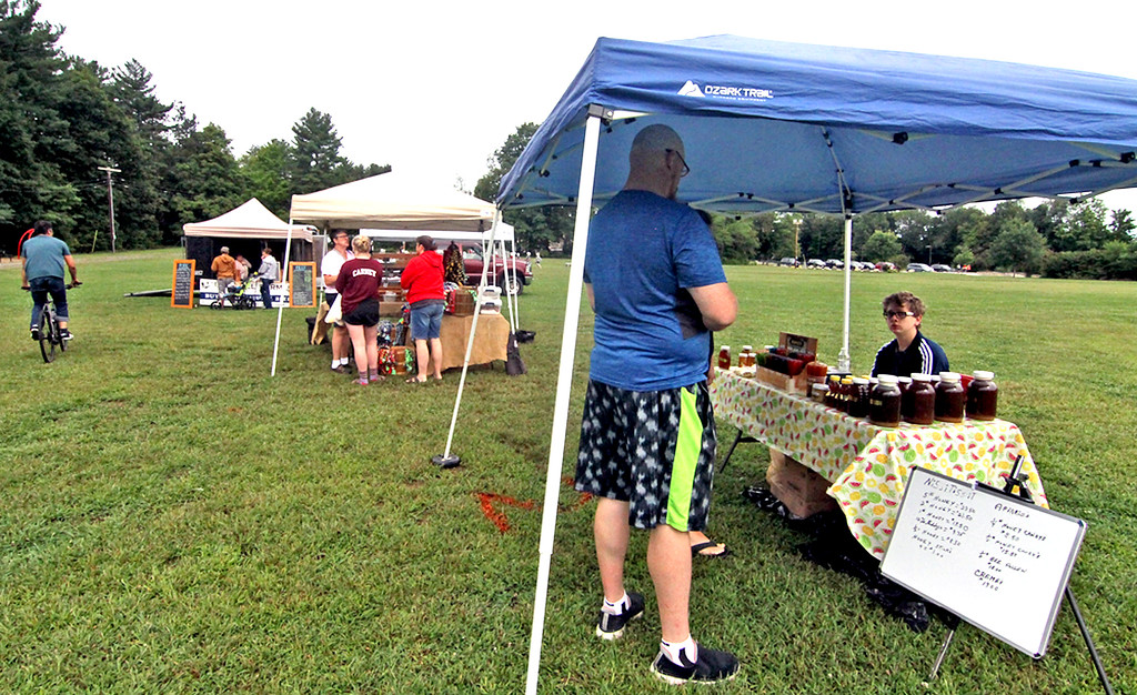 . Locals get an early start at the Pepperell Farmers Market. SUN/David H. Brow