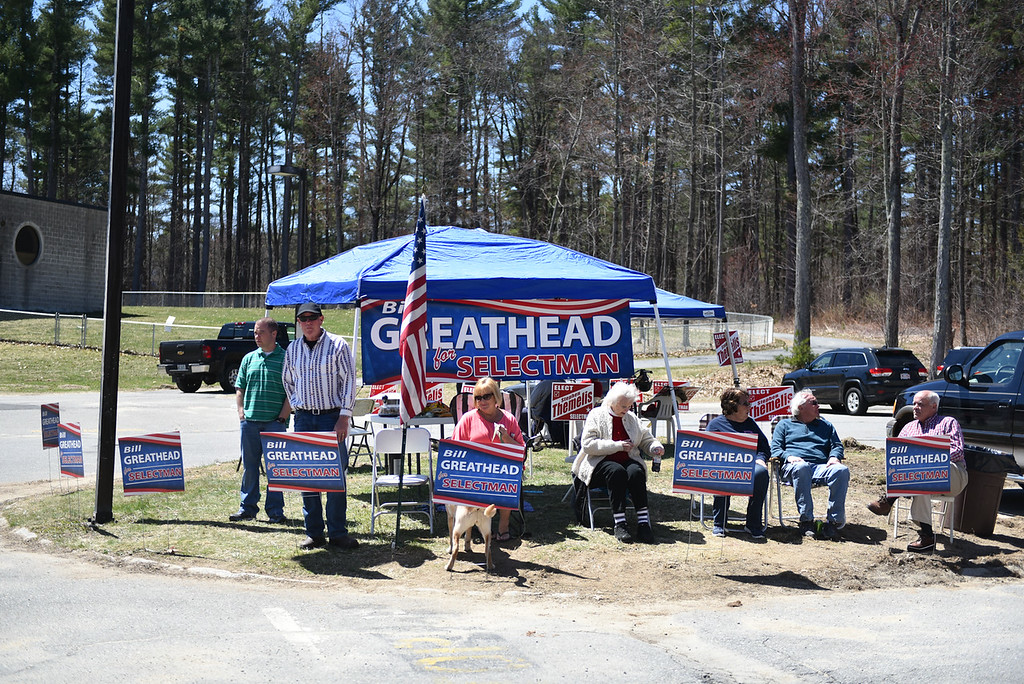 . Candidates and supporters stand outside Varnum Brook Elementary School in Pepperell during the town elections on Monday.  SENTINEL & ENTERPRISE JEFF PORTER