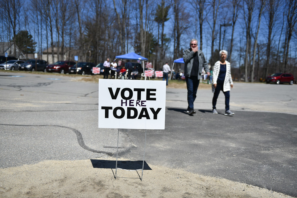 . Voters make way into Varnum Brook Elementary School in Pepperell as candidates and supporters stand outside during the town elections on Monday.  SENTINEL & ENTERPRISE JEFF PORTER