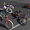 Recycled kids bikes lay on the basketball courts at the Pepperell Town Field on Saturday during Pepperell's annual town wide yard sale.  SENTINEL & ENTERPRISE JEFF PORTER