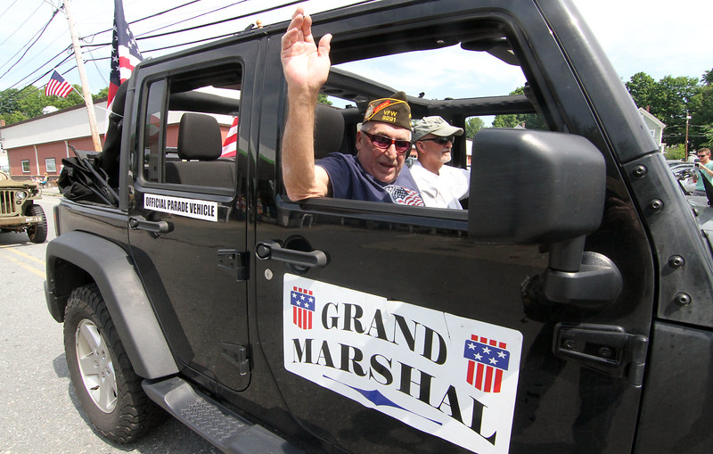 Grand Marshal Joe Moore waves to the local folks during thr Pepperell 4th of July Parade. SUN/David H.Brow