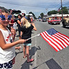 Waving her American Flag and all decked out in her 4th of July outfit during the annual Pepperell 4th of July Parade is Mackenzie Wilkins 8 years old from Pepperell. SUN/David H.Brow