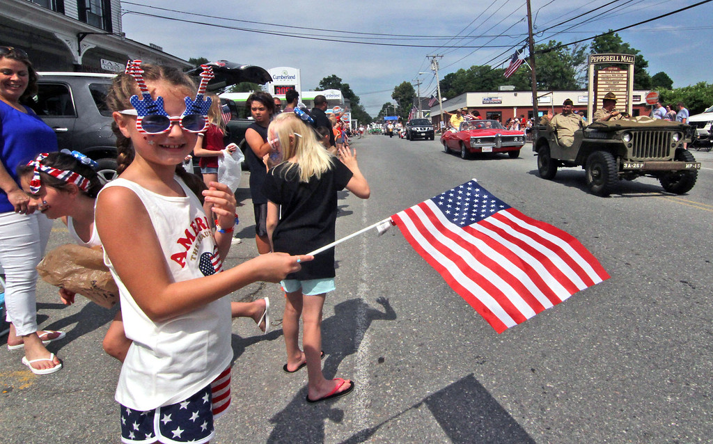 . Waving her American Flag and all decked out in her 4th of July outfit during the annual Pepperell 4th of July Parade is Mackenzie Wilkins 8 years old from Pepperell. SUN/David H.Brow