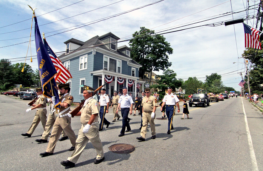 . Local veterans lead the Pepperell 4th of July parade through the center of town. SUN/David H.Brow