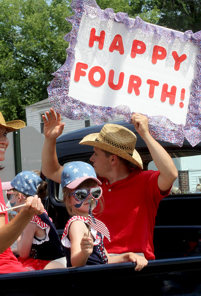 The sign says in all with this group riding during the Pepperell 4th of July parade. SUN/David H.Brow