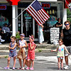 Local folks take in the annual 4th of July parade in Pepperell. SUN/David H.Brow