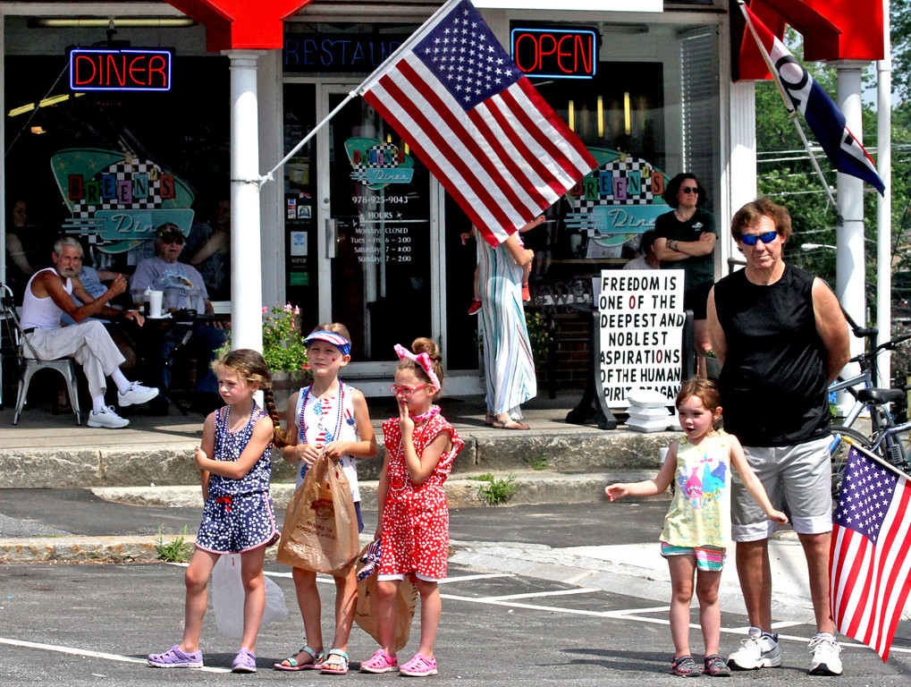. Local folks take in the annual 4th of July parade in Pepperell. SUN/David H.Brow