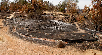 Blackkened rails outline the out-of-bounds area at the Peregrine Point Disc Golf Course was scorched by the Stoney Fire. The charred course is seen Tuesday, Aug. 14, 2018, in Chico, California. (Dan Reidel -- Enterprise-Record)