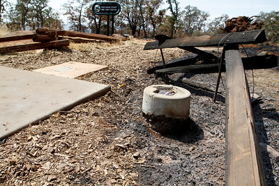From the tee at hole No. 1, rails and grass at the Peregrine Point Disc Golf Course were scorched by the Stoney Fire. The charred course is seen Tuesday, Aug. 14, 2018, in Chico, California. (Dan Reidel -- Enterprise-Record)
