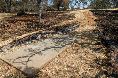 The Peregrine Point Disc Golf Course tee at hole No. 18 was scorched by the Stoney Fire. The charred course is seen Tuesday, Aug. 14, 2018, in Chico, California. (Dan Reidel -- Enterprise-Record)