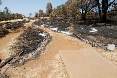 Fairway at hole No. 2. The Peregrine Point Disc Golf Course was scorched by the Stoney Fire. The charred course is seen Tuesday, Aug. 14, 2018, in Chico, California. (Dan Reidel -- Enterprise-Record)