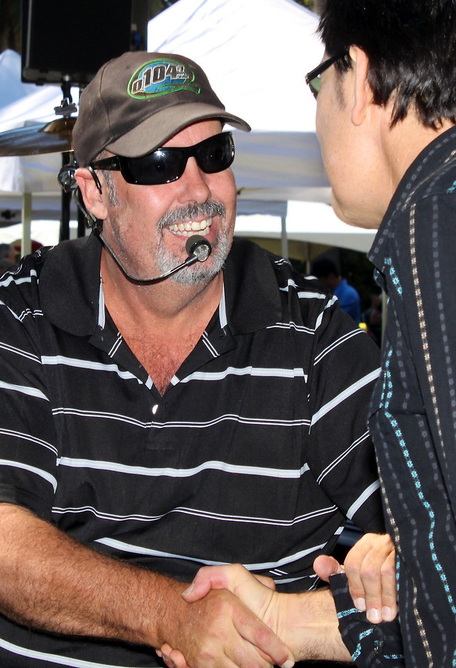 Caught Red Handed drummer Jon Cowsill thanks Tim Buley for keeping the crowd hopping as Act One of the Camarillo Country Music Festival and Chili Cookoff.  the annual event was attended by xxx people, and raised xxx for the festival's sponsor, Camarillo Hospice.