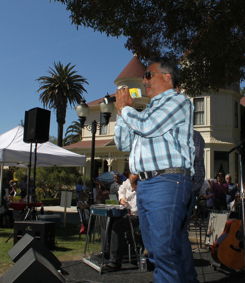 KHAY Country 100.7 Radio personality Just J leads a round of applause from the Camarillo Music Festival and Chili Cookoff bandstand at the Adolfo Camarillo Ranch House.<br /> the event hosted xxx visitors on Sunday, September fourth, and raised more then xxx for the host organization, Camarillo Hospice.