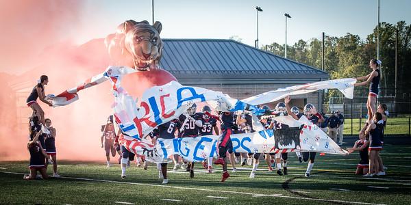Independence Cheerleaders, Arthur Cedeno (6), Kevin Acosta-Nunez (50), Dylan Rountree (33)