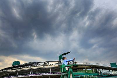 Tennis chair umpire Marija Čičak rules a match whilst dark clouds gather over the grounds and Centre Court, during the Wimbledon Tennis Championships 2017, All England Lawn Tennis and Croquet Club, UK