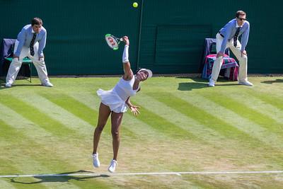 Venus Williams serves in her match against Kiki Bertens, round of 32 at Wimbledon 2018, London, UK