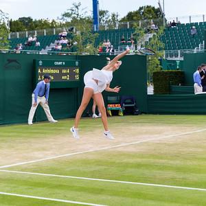 Amanda Anisimova, American tennis player, serves at the Wimbledon Championships 2016