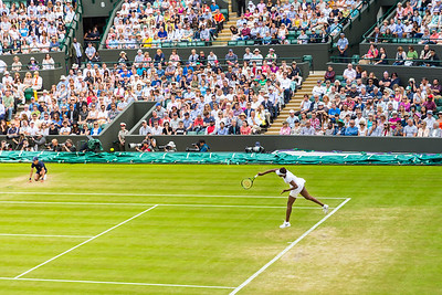 American tennis player Venus Williams serves during her ladies singles quarter final game at the Wimbledon 2016 Championships