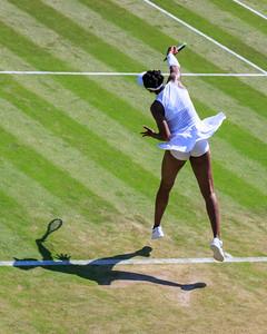 American Tennis Player Venus Williams serves during a match, Wimbledon 2018