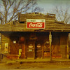 "© William Christenberry (b. 1936), Coleman's Cafe - Greensboro, Alabama from 15 Alabama Photographs,1971, color photograph, 3 1/8 x 4 7/8 in., Addison Gallery of American Art, Phillips Academy, Andover, MA, gift of William P. Heidrich and Arthur Grant Heidrich III, 2005.22.4<br /> From ""Frame by Frame"""