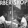 Lucien Aigner, Barber shop, Harlem, 1930s. Gelatin silver print, 13 11/16 × 10 3/16 in. (35.5 × 28 cm)