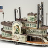George W. Brown & Co. (American, 1830–1889) Forestville or Cromwell, CT<br /> Riverboat Excelsior pull toy, ca. 1870<br /> Tinned sheet iron, iron, paint, paper,<br /> 14 x 21 x 7 in.<br /> New-York Historical Society, Purchased from Elie Nadelman, 1937.478
