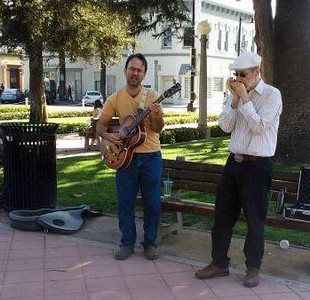 Oliver and me busking in Orange - May 26, 2013.  Photo by Travis Mead.