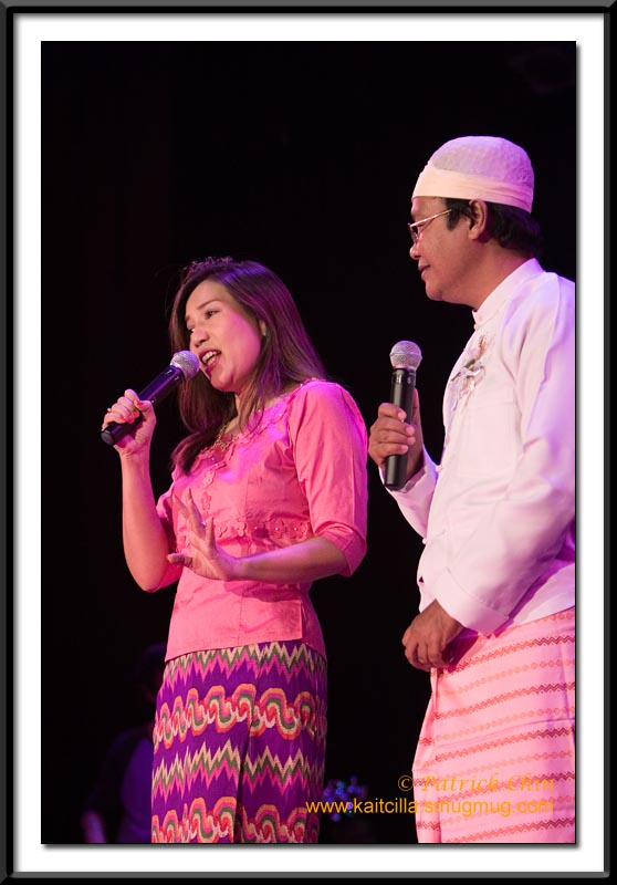 Duet performance of Than Myat Soe and Maykhala. Both are waring traditional Burmese clothes although the man's dress is more traditional and it's rarely seen on the street.