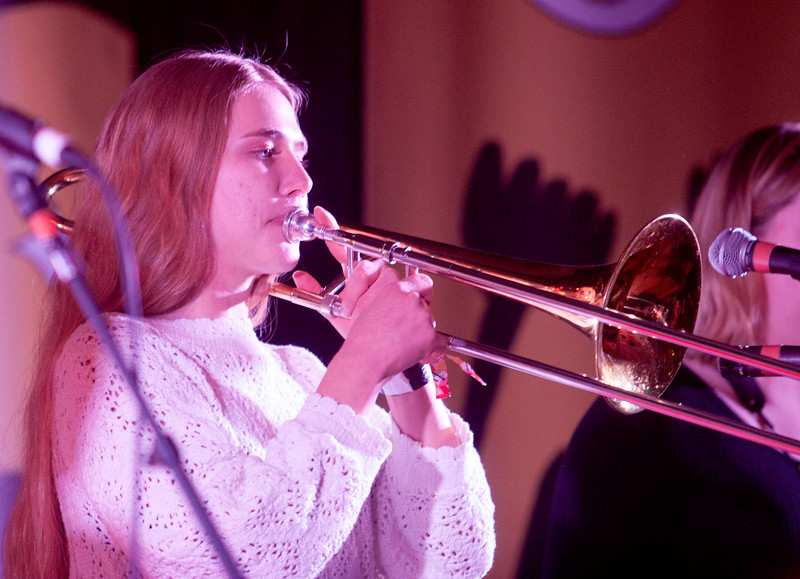 Martha Stax has a small, but mighty horn section.  Their trombonist is seen playing during their set at the El Korah Shrine in Boise, Idaho.