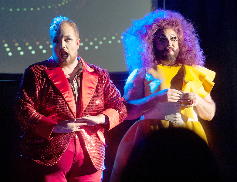 Big Gay Paycen and MissFyre do a duo act on stage at the Balcony.