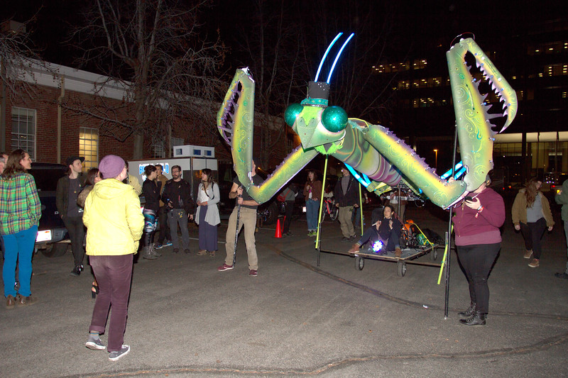 Mr. Barry Ro Mantis, the giant praying mantis macro puppet, entertains Treeforters in the parking lot of El Korah Shrine.  Puppeteers manipulated the arms and head to music on the opening night of Treefort Music Fest in Boise, Idaho.