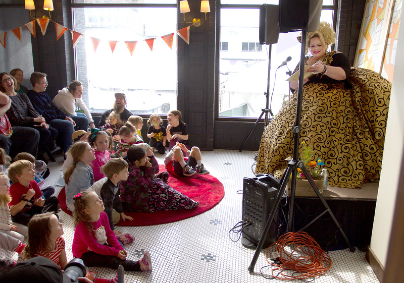Minerva Jayne reads a book to kids and their families near the lobby of the Owyhee Hotel on Friday. This was one of the events for Treefort, Boise, Idaho.