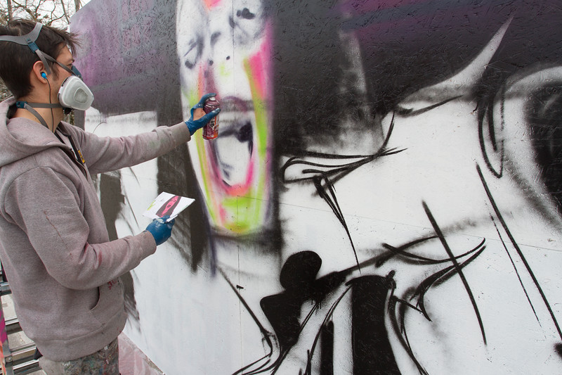 Garaffiti artist, Collin, with Sector 17, works his magic during Treefort, Boise, Idaho.