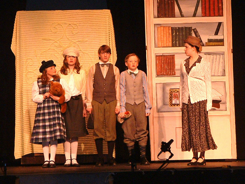 The Pevensie children - Lucy, Susan, Peter and Edmund - receive a cold welcome by Marbleton Manner's housekeeper, Mrs. Macready.