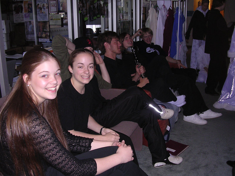Members of the orchestra relaxing before curtain time.