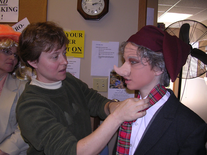 Allison Spencer straightens the tie on her son Chris who played The Dwarf.
