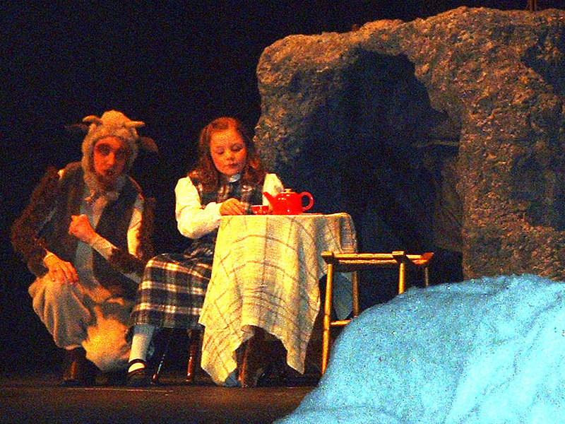 Lucy and Mr. Tumnus enjoy a spot of tea and cakes.
