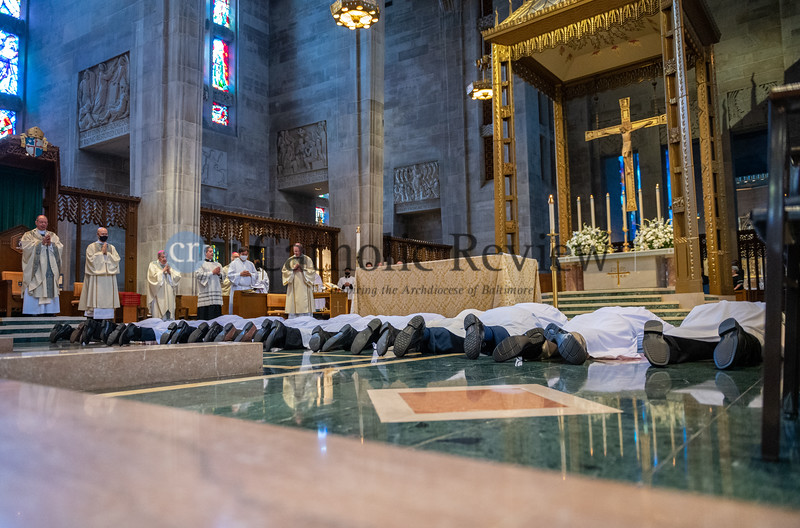 Thirteen men about to be ordained deacons prostrate in front of the altar during the Litany of Supplication, part of the permanent diaconate ordination May 22 at the Cathedral of Mary Our Queen in Homeland. (Kevin J. Parks/CR Staff)