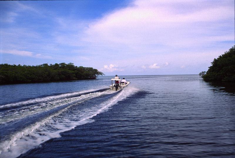 Flats Boat running a Creek Fly Fishing Turneffe Belize