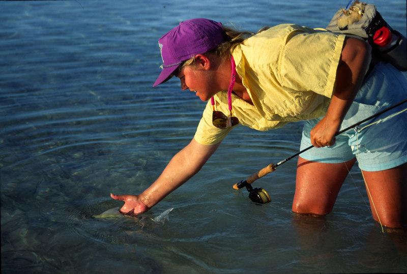Wendy Gunn Releasing Bonefish Fly Fishing Turneffe Belize