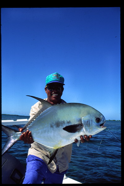 Guide Taku Holding Large Belize Permit Fly Fishing