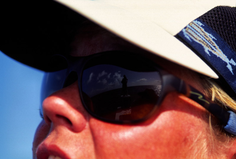 Reflection Of Poling Guide In Wendy Gunn's Glasses Fly Fishing Turneffe Belize