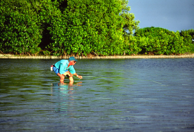 Jeff English Getting Low Stalking Bonefish Fly Fishing Turneffe Belize